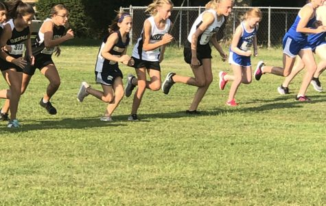 Meg Andersen (third from left) starts off strong in a race against older girls.