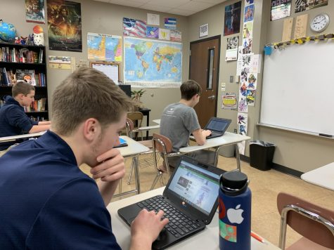 Senior Liam Carr, Freshman Jordan Suess, and Freshman Zac Zarski working on their Journalism stories in Mr. Mueller